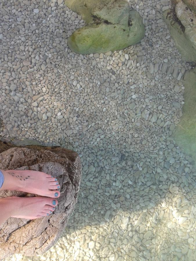 Crystal clear water under my feet royalty free stock photo