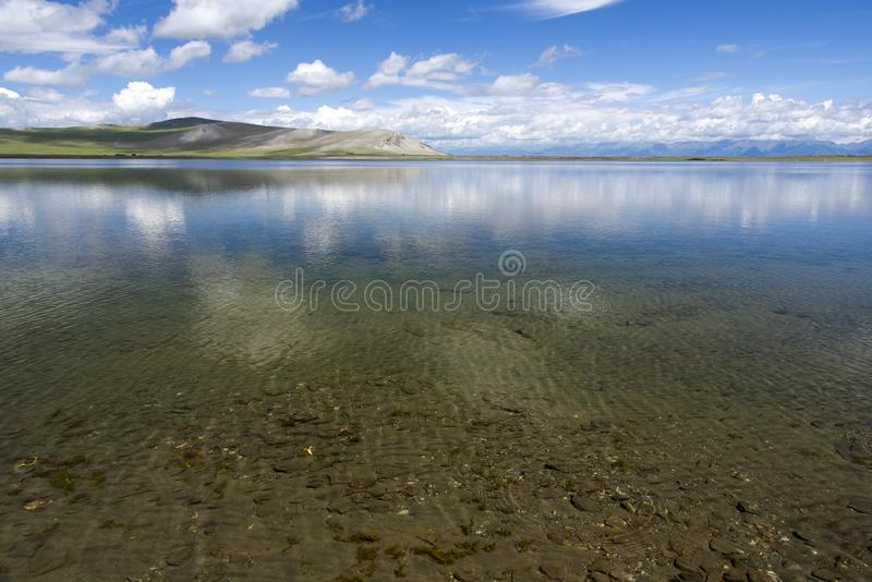 Crystal clear waters of northern Mongolia lake. The crystal clear waters of a nameless lake in Khövsgöl aimag in northern Mongolia royalty free stock image