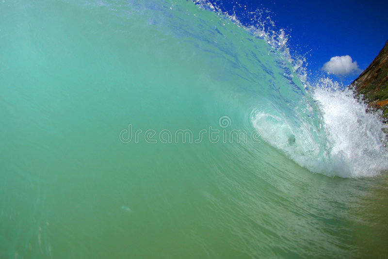 Crystal Clear Wave. A breaking wave at Sandy Beach on the island of Oahu, Hawaii stock images