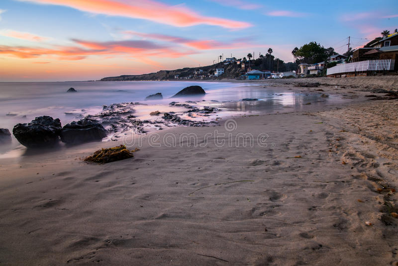 Crystal cove in Newport Beach. Colorful clouds at dusk in Newport Beach, California royalty free stock photography