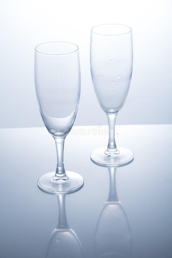 Crystal exponeringsglas på en vit bakgrund arkivbilder