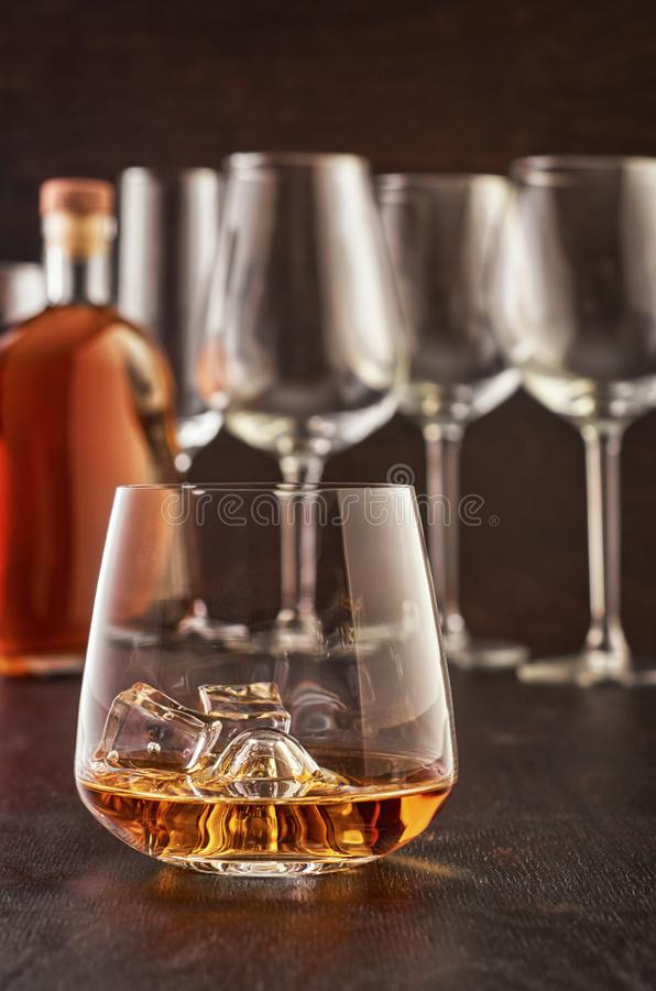 Crystal glass with whiskey on a wooden table stock images