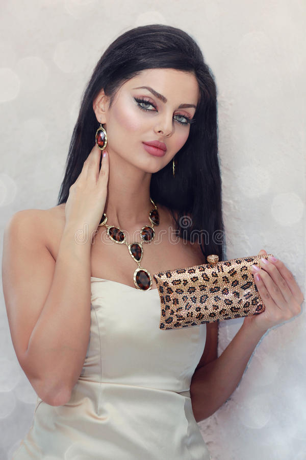 Crystal handbag. Young woman modeling with matching jewelry and handbag royalty free stock photography