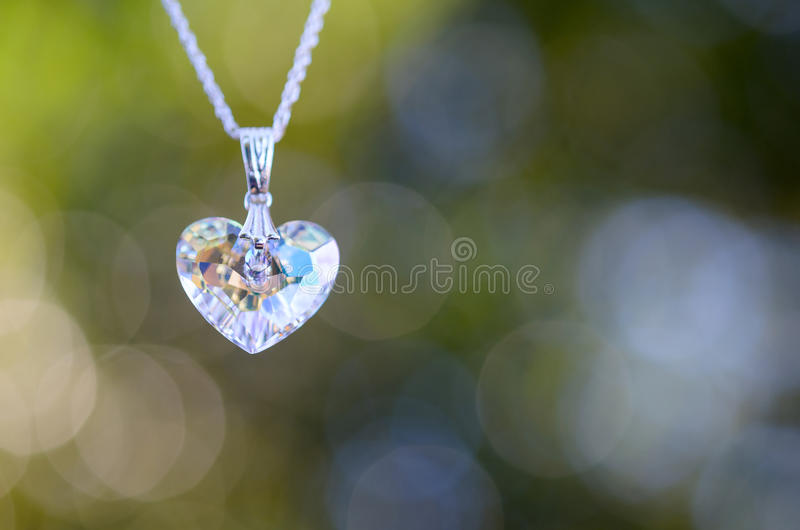 Crystal heart on Chain with Bokeh background royalty free stock photography