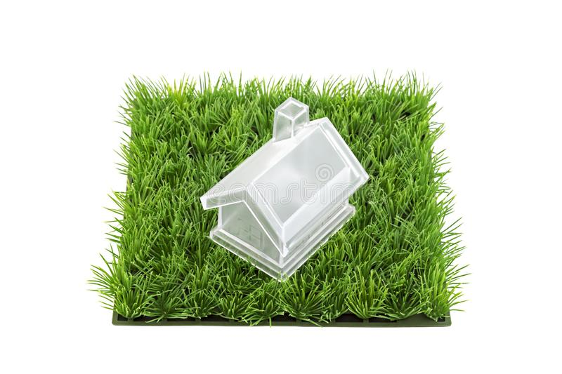Crystal house on square of green grass field royalty free stock photography