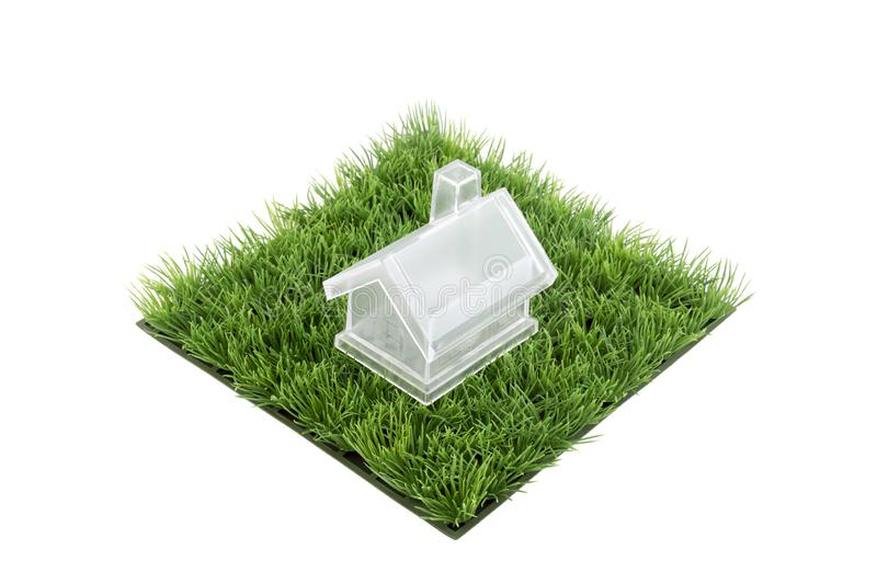 Crystal house on square of green grass field royalty free stock photo