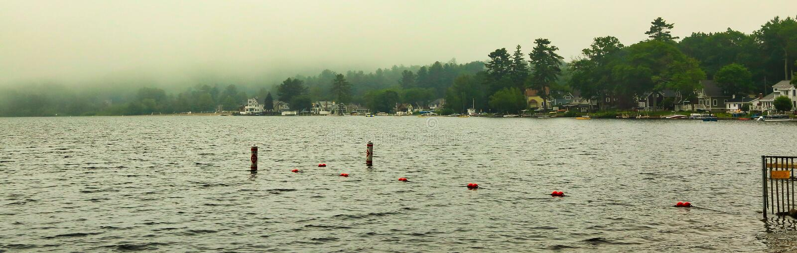 Crystal Lake Ellington Connecticut fog rain. Foggy rainy summer day on Crystal Lake in Ellington Connecticut stock images