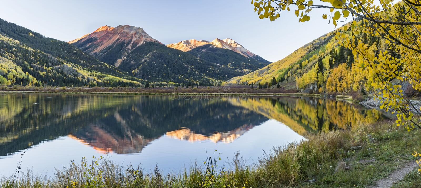 Crystal Lake Panorama Framed by Aspens stock photography
