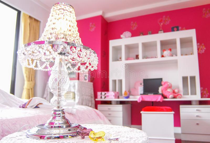 Crystal lamp. Reading crystal lamp in pink room stock images