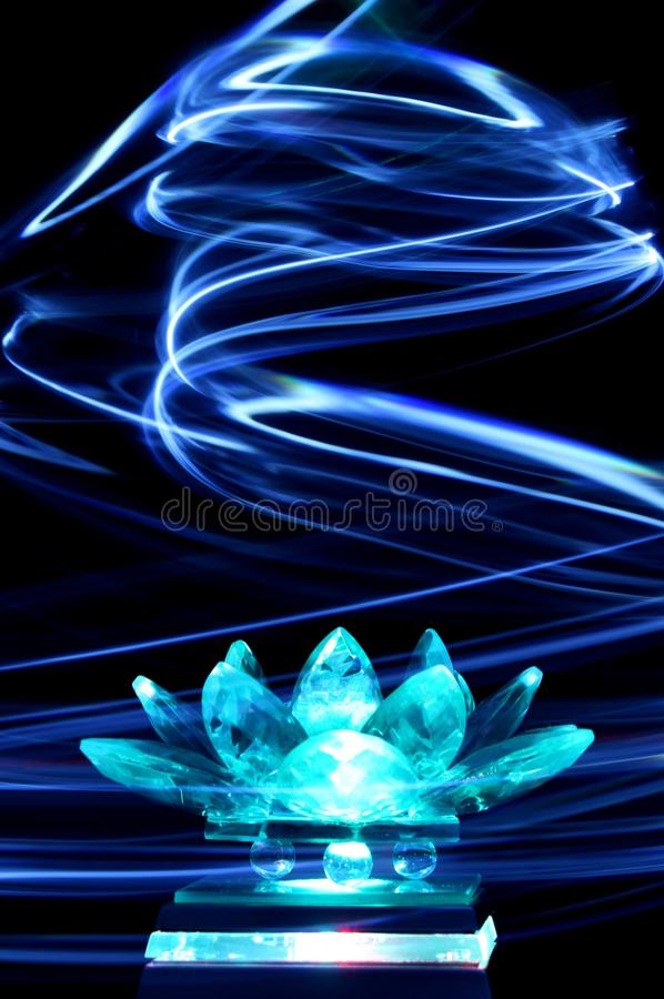 Crystal lotus flower in light painting stock images