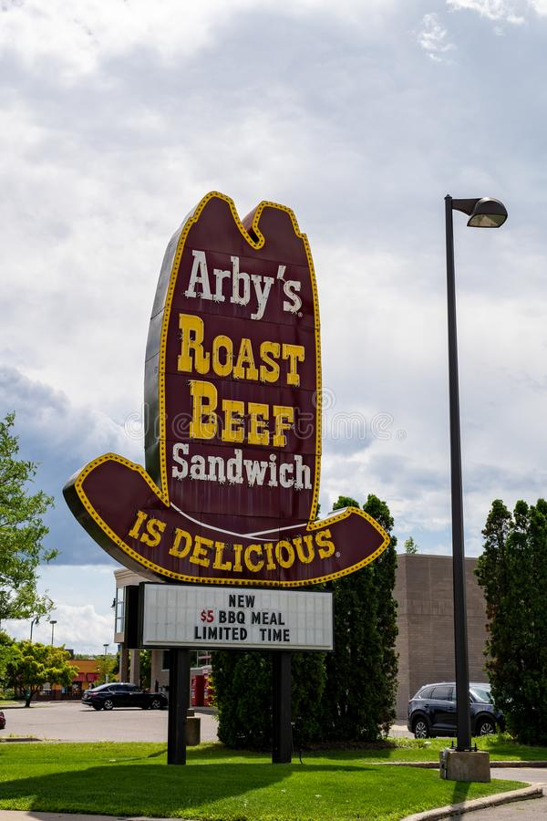 Classic cowboy hat old-school style Arby`s Roast Beef sign for the fast food restaurant. Crystal, Minnesota -: Classic cowboy hat old-school style Arby`s Roast stock photo