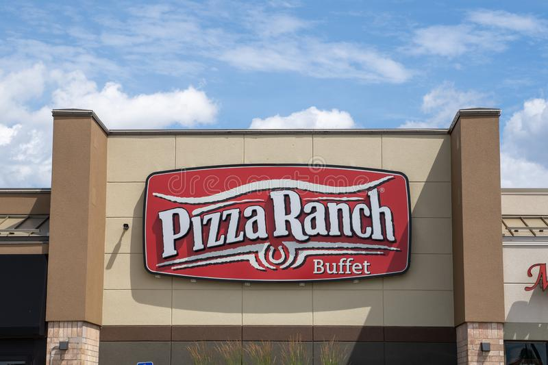 Crystal, Minnesota - July 21, 2019: Exterior of a Pizza Rach pizza buffet restaurant. These buffets are known for their old west. Exterior of a Pizza Ranch pizza stock photography