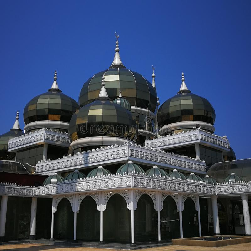 Crystal Mosque or Masjid Kristal, a grand structure made of steel, glass and crystal. View from below with clear sky . royalty free stock images
