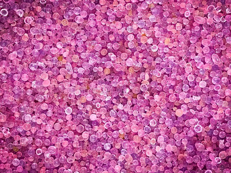 The crystal of pink silica gel expired and turn color from blue to pink or purple range, use for remove water or moisture. royalty free stock image