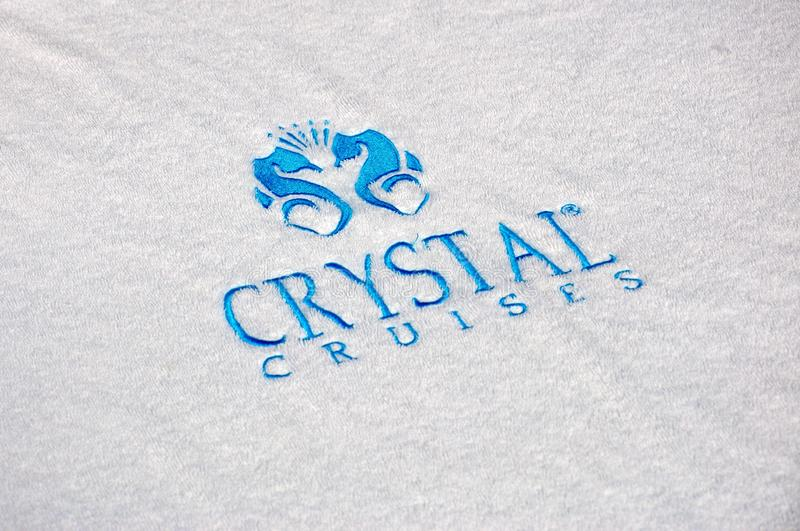 Crystal Serenity cruise ship open deck pool towel with Cryslal Cruises logo. Crystal Serenity beautiful luxury cruise ship docked in Miami Dodge Island during royalty free stock photo