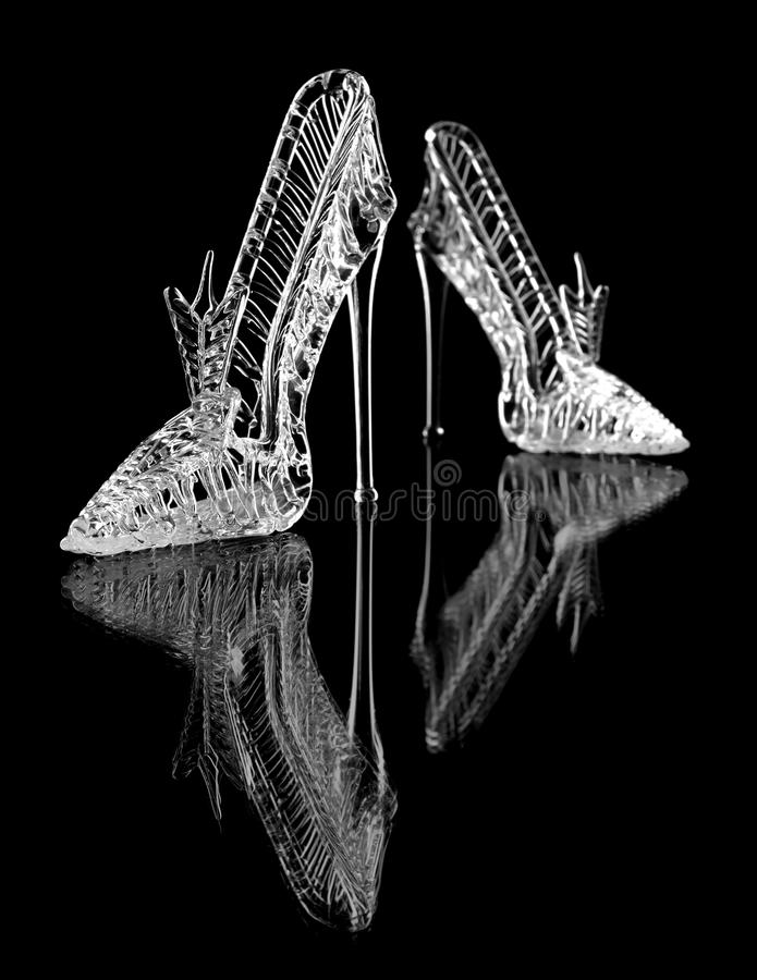 Crystal Shoe. A pair of crystal shoes on a black background with reflection stock image