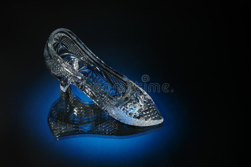 Crystal shoe on a blue royalty free stock photography