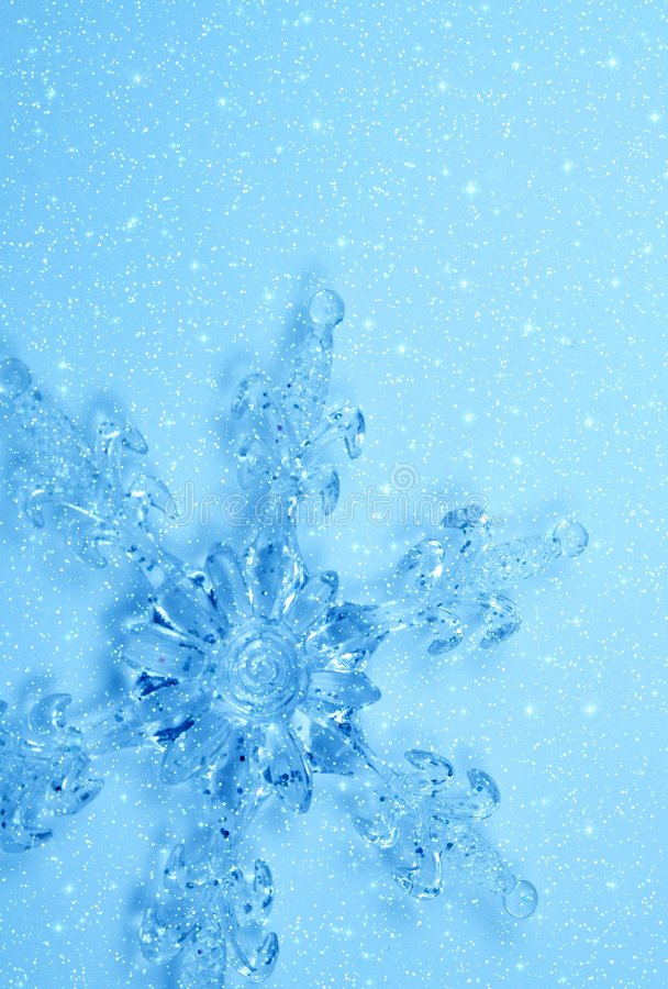 Crystal snowflake in snow