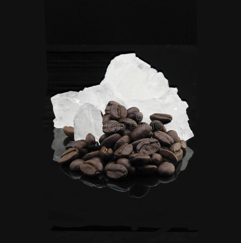 Crystal sugar and coffee beans stock image