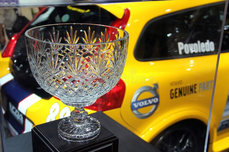 Crystal winner cup with a sports car. At the background at the Canadian International Auto Show 2012 in Toronto stock photography