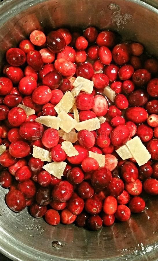 Crystallized ginger and cranberry. Cooking Cranberry relish sauce for thanksgiving royalty free stock images
