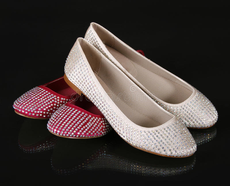 Crystals encrusted beige and red flat shoes royalty free stock photos