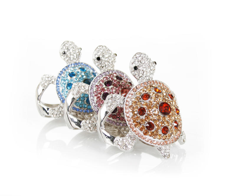 Crystals encrusted turtles bracelets royalty free stock photo