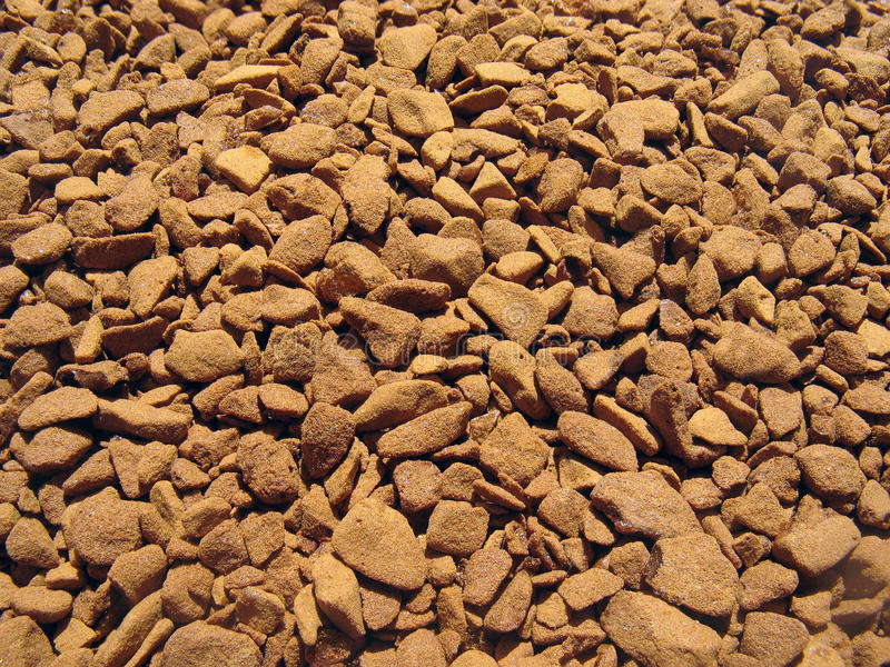 Granules of the instant coffee - background stock image