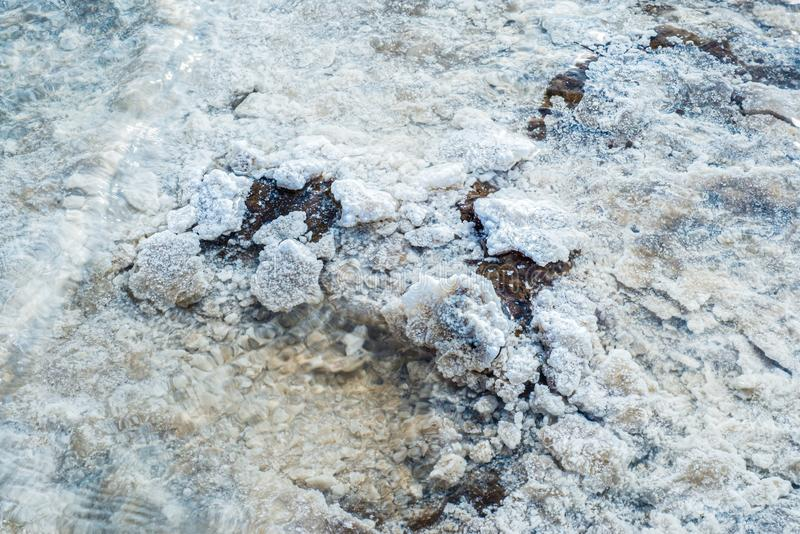 Crystals of natural salt in the lifeless hot terrain on the salt lake Baskunchak. Russia. Astrakhan region royalty free stock photos