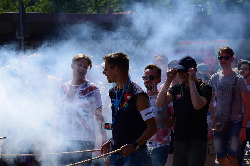 CSD, gay pride parade 2015 in Luebeck, Germany, , happy young me. Luebeck, Germany, August 22, 2015: CSD (Christopher Street Day) gay pride parade in Luebeck stock photos