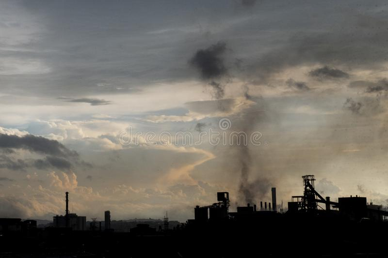 CSN - Volta Redonda. Volta Redonda, Brazil - march 19, 2019: horizon line at dusk with CSN's steel industry, with smoke in counter-light air background royalty free stock images