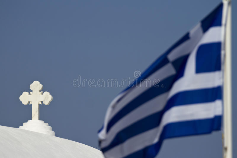 CTOC da igreja e bandeira grega imagem de stock royalty free