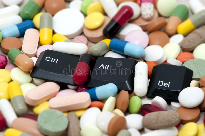 Ctrl, Alt, Del keys among drugs (Enter system, restart system) royalty free stock image