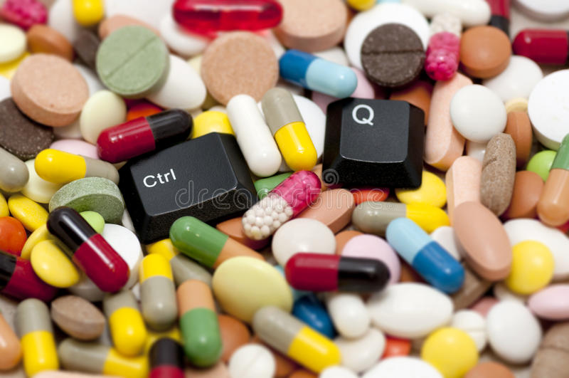 Ctrl and Q keys among drugs (Quit system, quit drugs) stock photo
