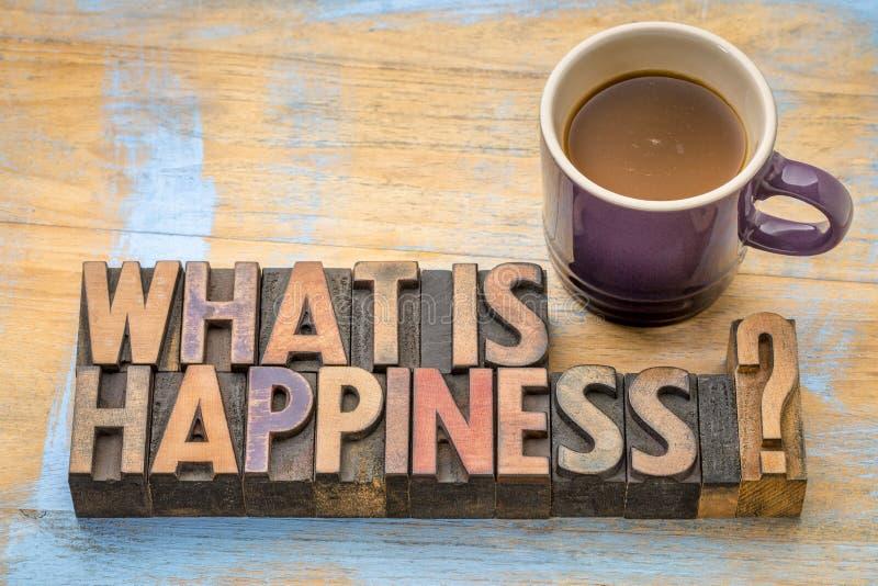 Cuál es pregunta de la felicidad en el tipo de madera foto de archivo libre de regalías