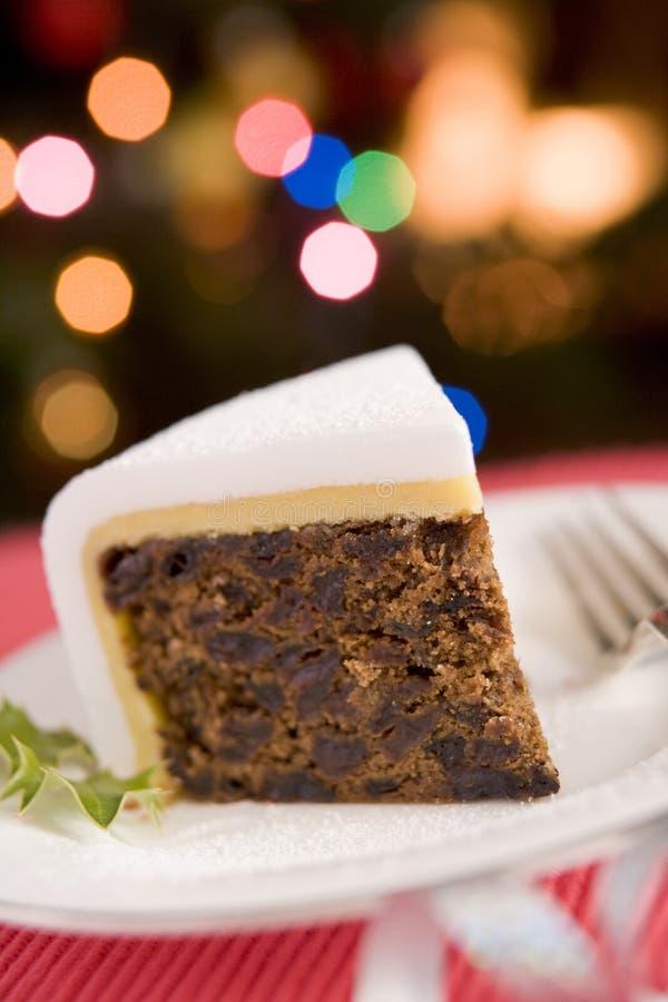 Cuña de la torta de la Navidad imagen de archivo