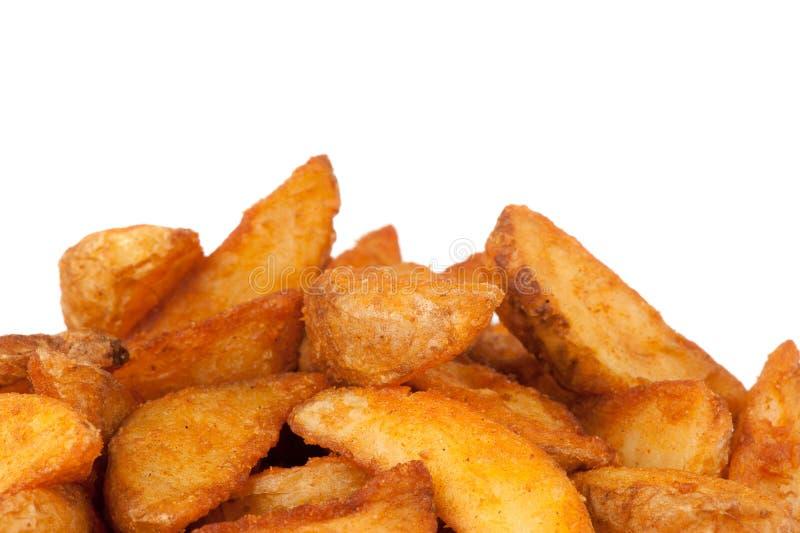 Cuñas fritas de la patata. Alimentos de preparación rápida fotografía de archivo libre de regalías