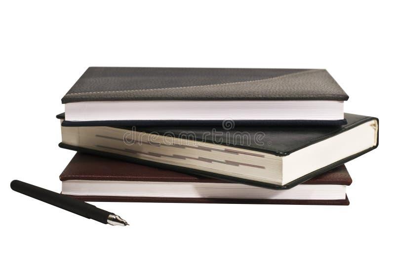 Cuaderno aislado en un fondo blanco imagen de archivo