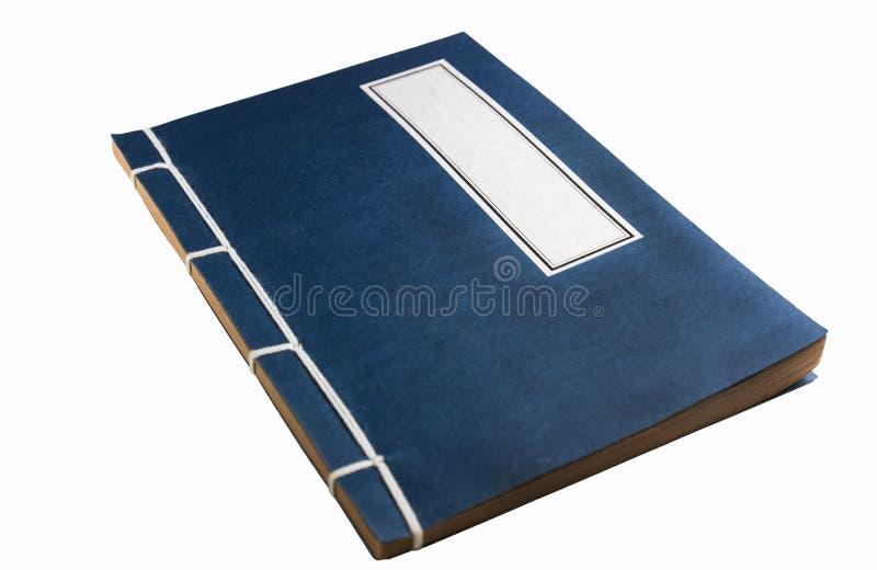Cuaderno azul del Chino-estilo, aislado en blanco imagenes de archivo