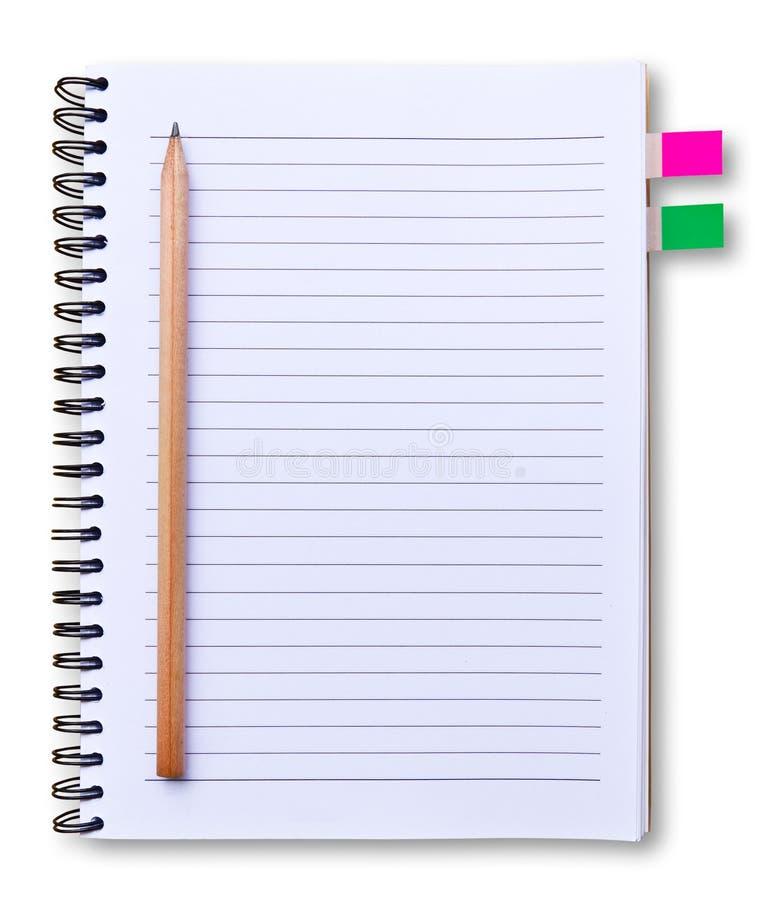 Cuaderno blanco y lápiz aislados imagen de archivo