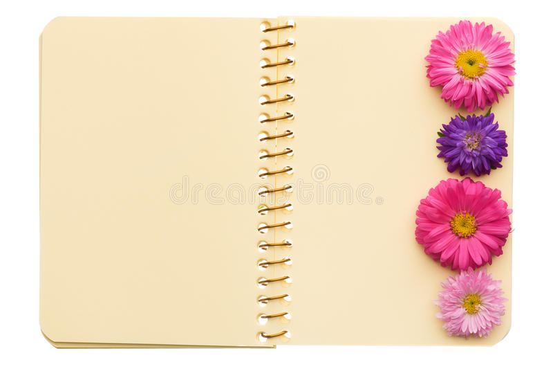 Cuaderno con las flores fotografía de archivo