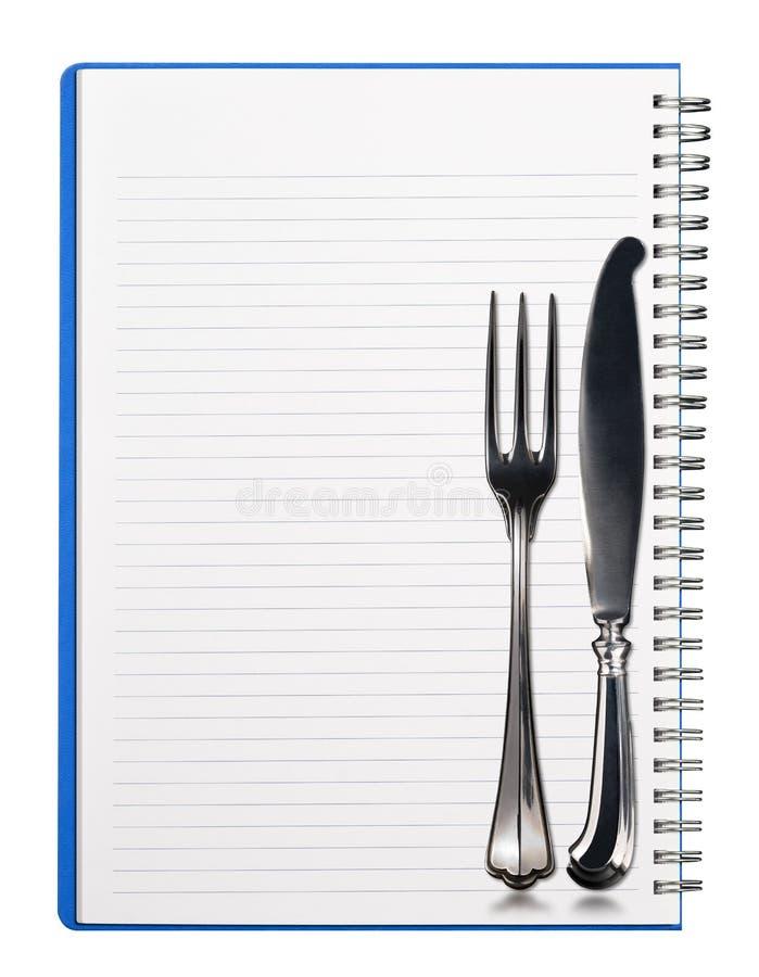 Cuaderno con los cubiertos de plata imagen de archivo libre de regalías