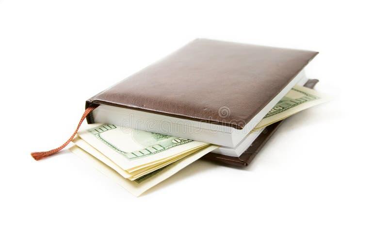 Cuaderno con un dinero imagenes de archivo