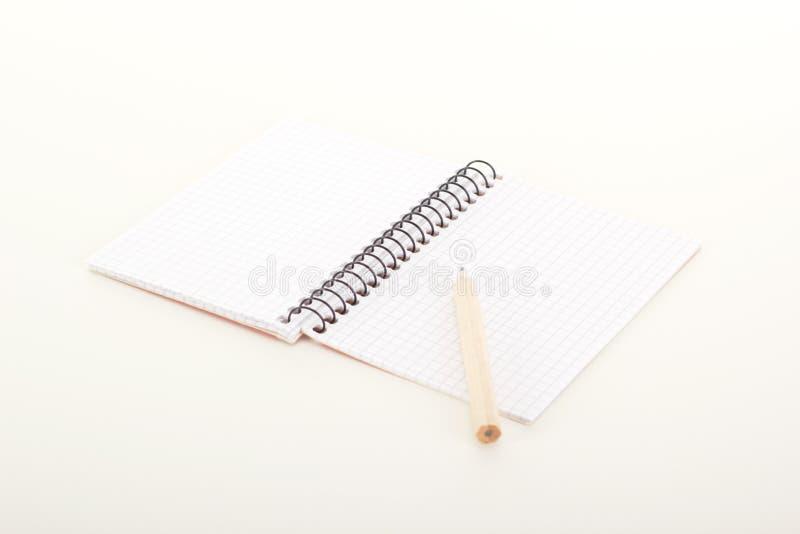 Cuaderno de notas con el lápiz fotografía de archivo