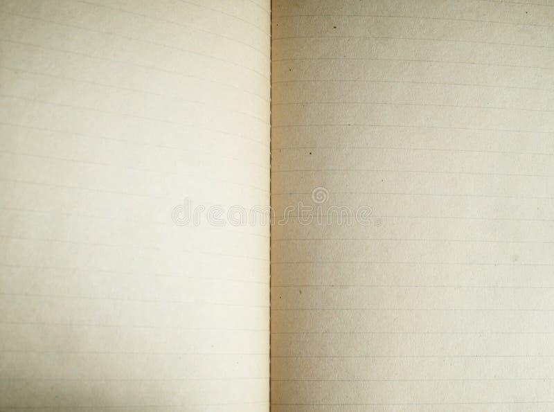 Cuaderno de papel de la paginación texturizado aislado en los fondos blancos imagenes de archivo