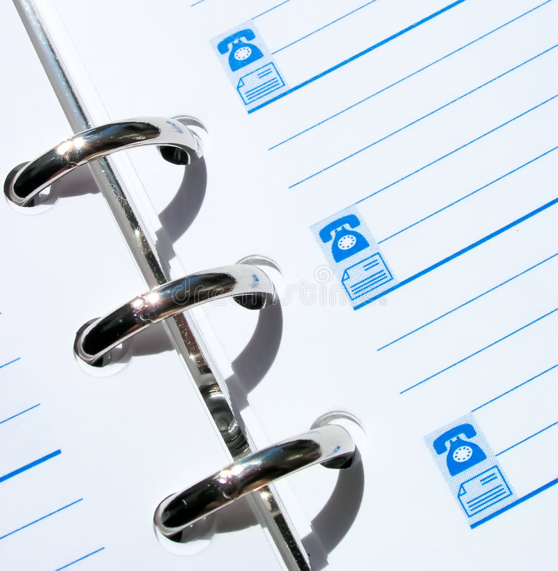 Cuaderno del teléfono foto de archivo libre de regalías