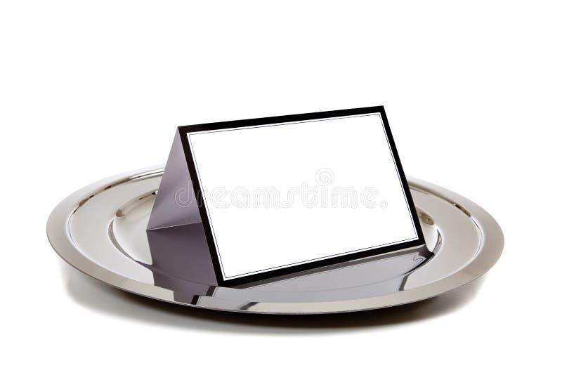 Cuaderno en blanco en una bandeja de plata imagen de archivo libre de regalías