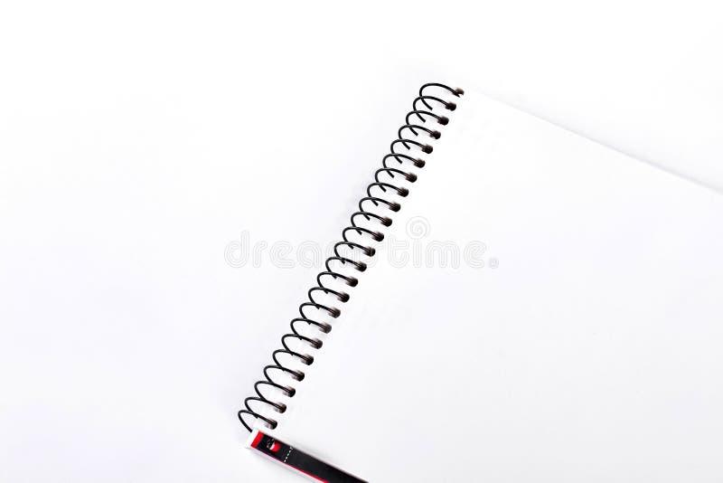 Cuaderno espiral de la carpeta, fondo blanco imágenes de archivo libres de regalías