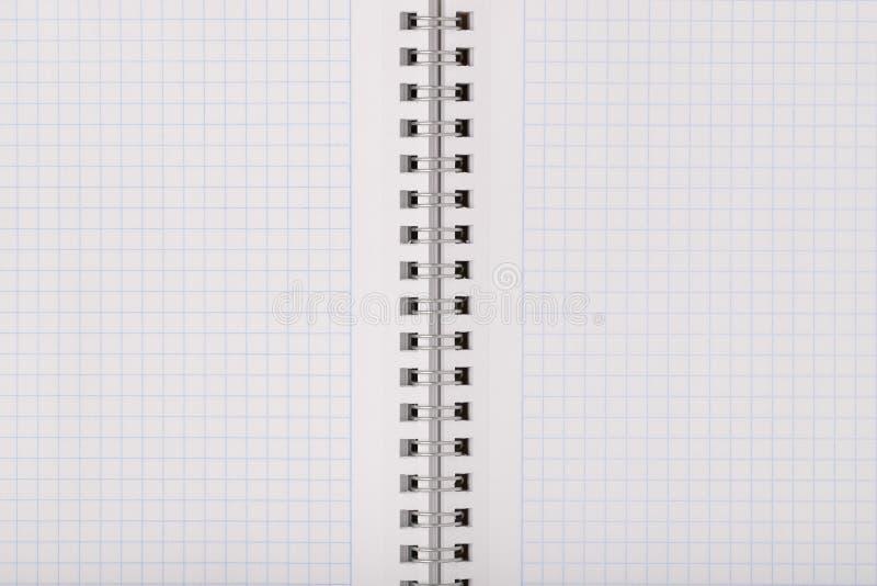 Cuaderno limpio vacío en hoja de la rejilla imágenes de archivo libres de regalías