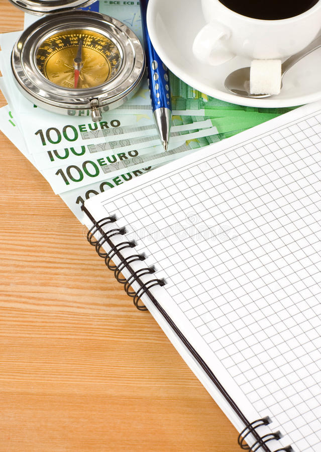 Cuaderno y café con euro fotografía de archivo libre de regalías